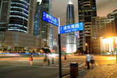 Road signs the night scene of Shanghai City — Stockfoto