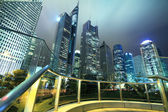 Looking up at the modern office buildings at night in Shanghai — Stock Photo