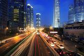 Urban transport traffic rainbow light trails — Stock Photo