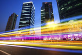 Rainbow light highway at night in Shanghai — Stock Photo