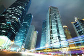 Modern office buildings background at night in Shanghai — Stock Photo