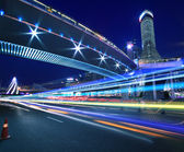 Rainbow light highway at cityscape night in Shanghai — Stock Photo