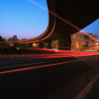 Постер, плакат: Large urban highway long exposure photo light night scene