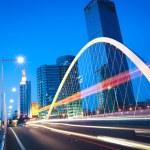 Arc bridge girder highway car light trails city night landscape — Stock Photo #46464079
