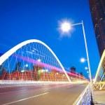 Arc bridge girder highway car light trails city night landscape — Stock Photo #46464415