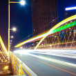 Arc bridge girder highway car light trails city night landscape — Stock Photo #46464933