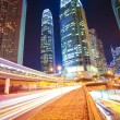 Road tunnels light trails on modern city buildings backgrounds i — Stock Photo #46473273