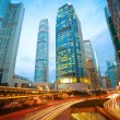 Road tunnels light trails on modern city buildings backgrounds i — Stock Photo #46471361