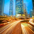 Road tunnels light trails on modern city buildings backgrounds i — Stock Photo #46471903