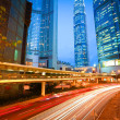 Road tunnels light trails on modern city buildings backgrounds i — Stock Photo #46472363
