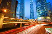 Road tunnels light trails on modern city buildings backgrounds i — Stock Photo