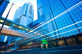 Hong Kong of City car with light trails of modern urban building — Stock Photo