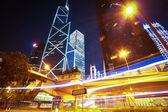 Road light trails on modern city landmark buildings in HongKong — Stock Photo