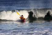 Kayak surfer in action — Stock Photo