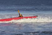 Kayak surfer hitting a rough wave — Stock Photo