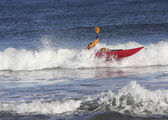 Kayaker on the crest of a wave — Stock Photo