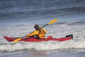 Man fighting the wave on kayak on rough sea — Stok fotoğraf