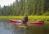 Young woman in kayak on a pond — Stock Photo