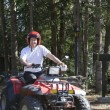 Young man riding a Quad  — Stock Photo