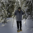 Stock Photo: Aged senior with snowshoes