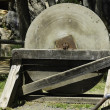 Stock Photo: Antique millstone
