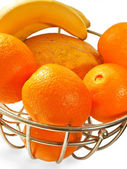 Metal basket with orange fruits isolated on a white — Stock Photo