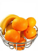 Metal basket with orange fruits isolated on a white background — Stock Photo