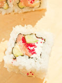 Closeup of a sushi roll on the desk — Stok fotoğraf