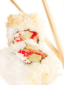 Two sushi roll with chopsticks over white — Photo