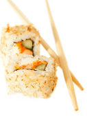 Two sushi rolsl with tuna flakes and chopsticks over white — Stock Photo
