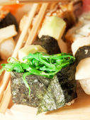 Sushi with seaweed around sushi set — Stok fotoğraf
