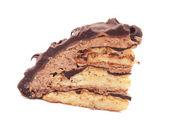 Beyaz arka plan üzerinde izole kek dilim çikolatalı badem ezmesi — Stok fotoğraf