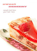 Cheesecake with strawberry on sauser with spoon isolated on whi — Stock Photo