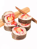 Rolls with shrimp, salmon and red masago and chopstick isolate — Stock Photo
