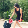 Beautiful girl walks with a suitcase — Stock Photo #13181874
