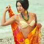 Woman in bikini and pareo at sea background — Stock Photo #13203924