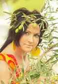 Kvinnor i bilden av olivolja nymf. — Stockfoto