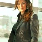 Busineeslady in grey pantsuit portrait — Stock Photo