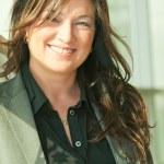 Portrait of smileing busineess lady in grey pantsuit — Stock Photo