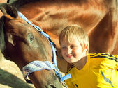 Little boy with horse portraits — Foto Stock