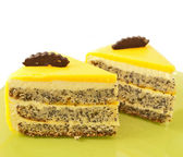 Two Slice of delicious mango cake with poppy on green plate — Stock Photo