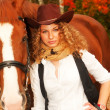 Beautiful cowgirl with her red horse. soft focus — Stock Photo #13558144