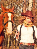 Running cowgirl with her red horse. — Stock Photo