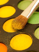Professional make-up brush on colorful eyeshadow — Stock Photo