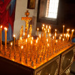The candles in Tikhvin male Monastery, Tikhvin, Russia — Stock Photo