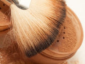 Face powder and brush. macro — Stock Photo