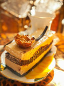 Vienna cake with almond and caramel in the cafe — Stock Photo