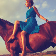 Young girl  on horse — Stock Photo