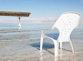Plastic easy chair in the shallow waters of the world famous De — Stock Photo