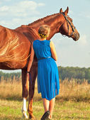 young beautiful  girl  with her horse — Stock Photo